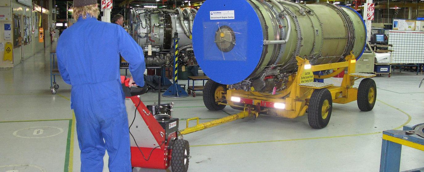 Nu-Star Power Pusher pulling an aeroplane engine